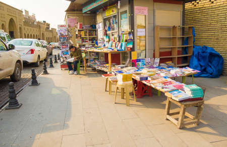 daily newspaper: Small book shop in Erbil selling kurdish books and daily newspaper in Kurdish language in Erbil city,Iraq