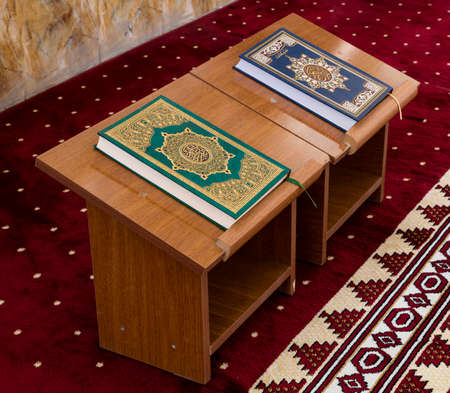 koran: Holly Koran or Quran on wooden table inside mosque