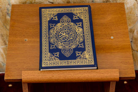 Holly Koran or Quran on wooden table inside mosque