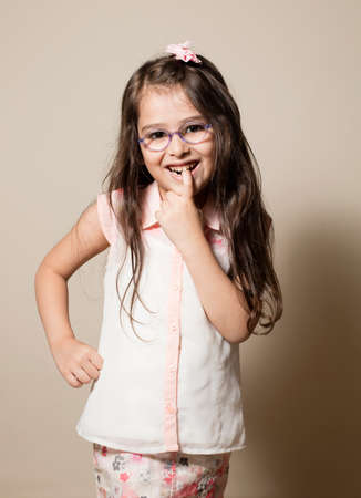 Small Girl with transparent glasses in lovely situation