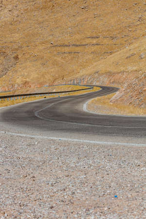 Curved road in Iraqi countryside located in Kurdistan region