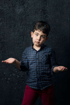 Boy in Strange pose with dark color outfit