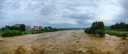 rains: Flood on river in a city after spring rains