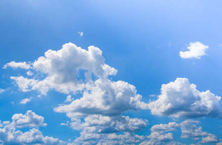 puffy: Blue sky with puffy white clouds in bright  sunny day Stock Photo