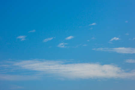 puffy: Blue sky with puffy white clouds in bright clear sunny day