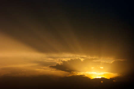Dramatic sunset sky with beames of light through clouds Stock Photo