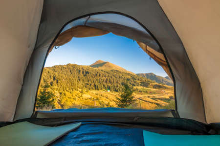 View from inside of hikers tourist tent in mountains