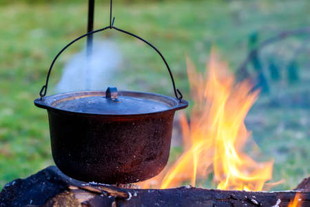 campsite: Camping kitchenware - pot on the fire at an outdoor campsite Stock Photo