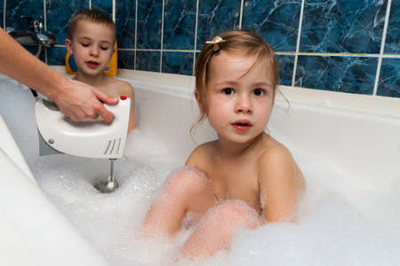 Brother And Sister Taking Bath