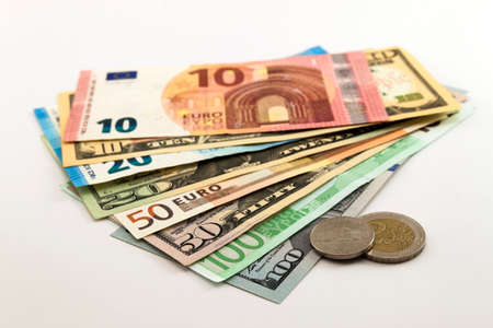 one hundred euro banknote: US dollar bills and Euro bills spread mixed on white background.