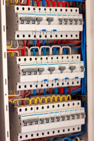 fusebox: Electical distribution fuseboard. Electrical supplies. Electrical panel at a assembly line factory. Controls and switches. Electricity distribution box. Fusebox. Stock Photo