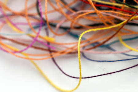 Multi-colored tangled colorful needlecraft silk thread rope. Macro shot. Abstract colors background 스톡 콘텐츠