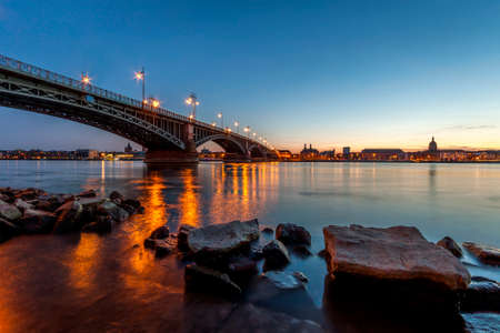 Beautiful sunset over Rhine  Rhein river and old bridge in Mainz near Frankfurt am Main, Germany. Editorial