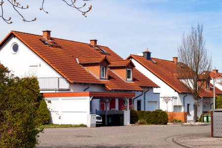 attic: Classic german residential houses with orange roofing tiles and windows