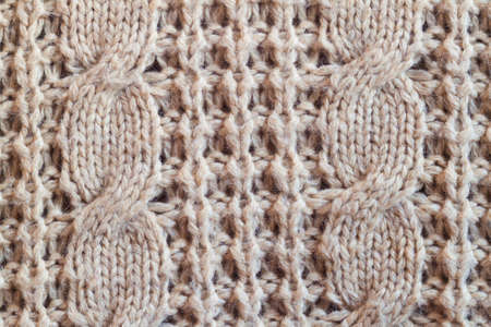 cable knit: Creamy wool knitted warm clothes for the winter fabric texture background