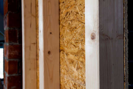 attic: Close up detail of house construction wooden wall elements. Interior frame renovation work Stock Photo