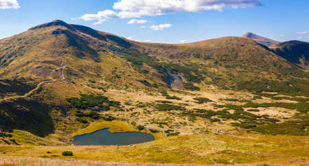 Panorama of Carpathian mountains in summer sunny day Stock Photo
