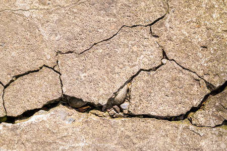 Cracked cement concrete texture closeup background. Old wall texture Stock Photo