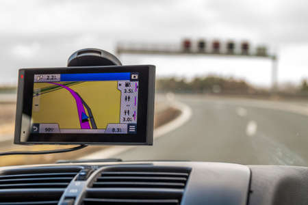 Close-up of gps navigation system device in travelling car