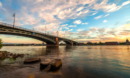 Beautiful sunset over Rhine / Rhein river and old bridge in Mainz near Frankfurt am Main, Germany.