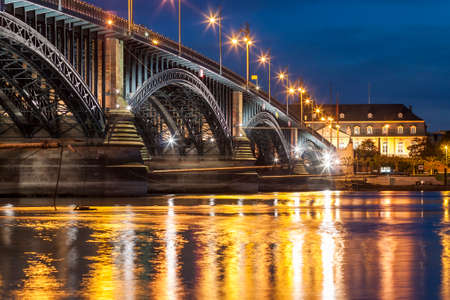 Beautiful sunset night over Rhine  Rhein river and old bridge in Mainz near Frankfurt am Main, Germany. Stock Photo