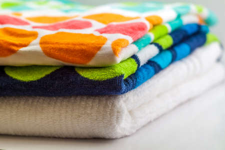 Colorful cotton bath towels on white background