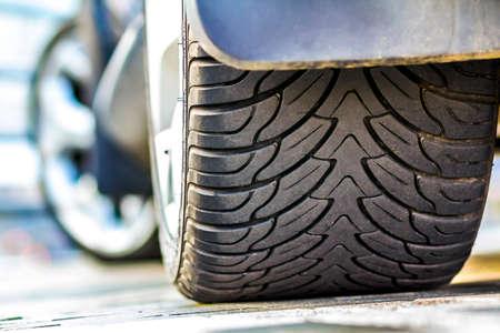 Close up of car tire, selective focus. Stock Photo