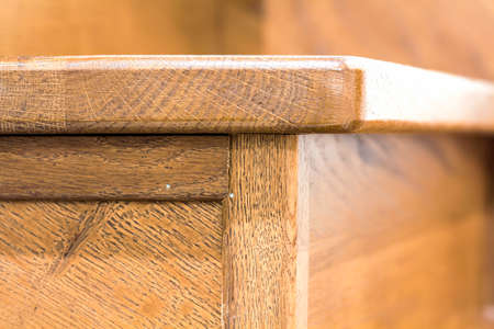 Detail close-up image of wooden oak stairs in house interior Stock Photo