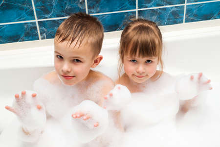 cute guy: Portrait of pretty children little girl and boy in bath. Hygiene concept.