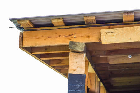 Detail of roofing construction on a new house. Wooden boards frame Stock Photo