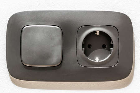 Close-up of black electric socket with light switch Stock Photo