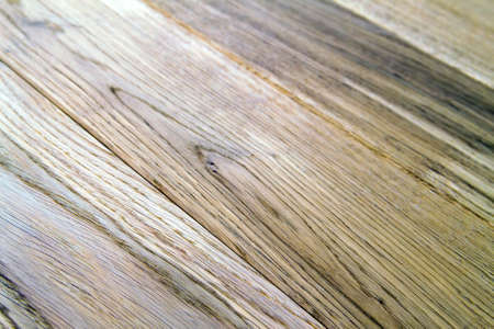 Several planks of beautiful laminate or parquet flooring with wooden texture as background