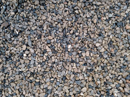Background with different small sea pebble stones Standard-Bild