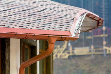 Detail image of new roof with gutter rain system 스톡 콘텐츠