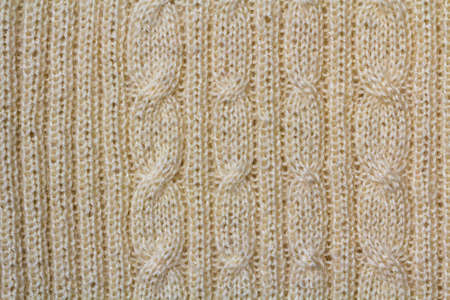 Background texture of beige pattern knitted fabric made of cotton or wool closeup Stock Photo