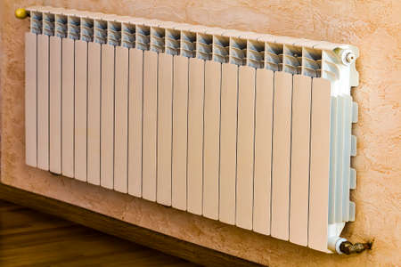 White metal heating radiator in new renovated interior Foto de archivo