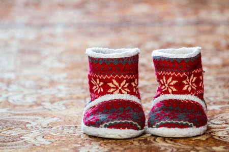 Red winter christmas boots with ornament pattern