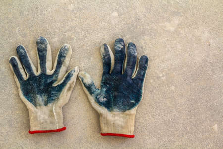 Used old dirty torn workers gloves as a metaphor, concept or symbol for the end of the work season