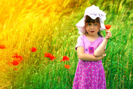 Little  displeased and dissatisfied cute girl with red flower Stock Photo