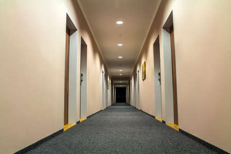 Photo of empty passageway corridor in luxury house.