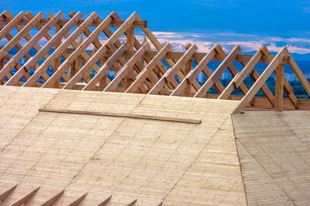 Wooden roof. House roof under construction. Roofing construction.
