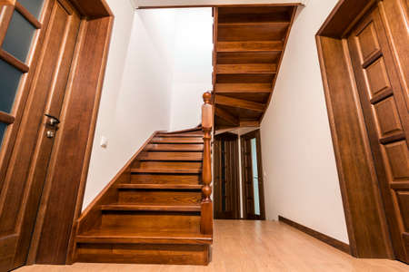 Modern Brown Oak Wooden Stairs And Doors In New Renovated House Interior  Stock Photo   95645579