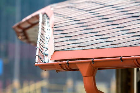 Detail image of new roof with gutter rain system Stock Photo - 97757222