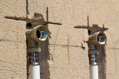 Water pipes made of polypropylene in the wall, plumbing in the house. Banco de Imagens