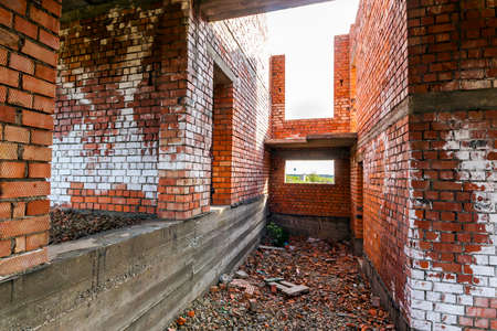 Interior of an old building under construction. Orange brick walls in a new house.