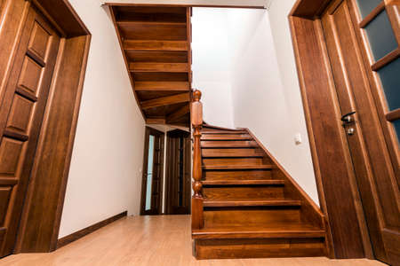 Modern Brown Oak Wooden Stairs And Doors In New Renovated House Interior  Stock Photo   99810900