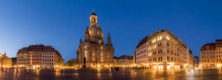 Long exposure of the Neumarkt square and Frauenkirche (Church of Our Lady) in Dresden on clear night, city square with unrecognizable tourists and locals. Historic architecture buildings in Germany.