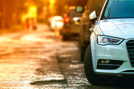 Close-up view of a new modern car parked on the side of the street. Soft ligtht effect. Stockfoto