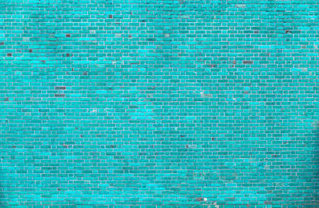 Close-up of natural old vintage weathered blue not plastered solid brick wall. Abstract copy space background, Bricklaying, construction and masonry concept.