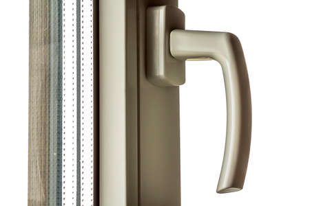 White handle on a new plastic window in renovated house Stock Photo